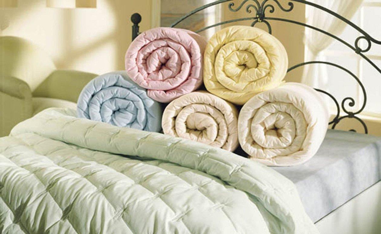 Одеяла красивые сложенные